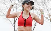 People in half-naked run to promote green life in Beijing
