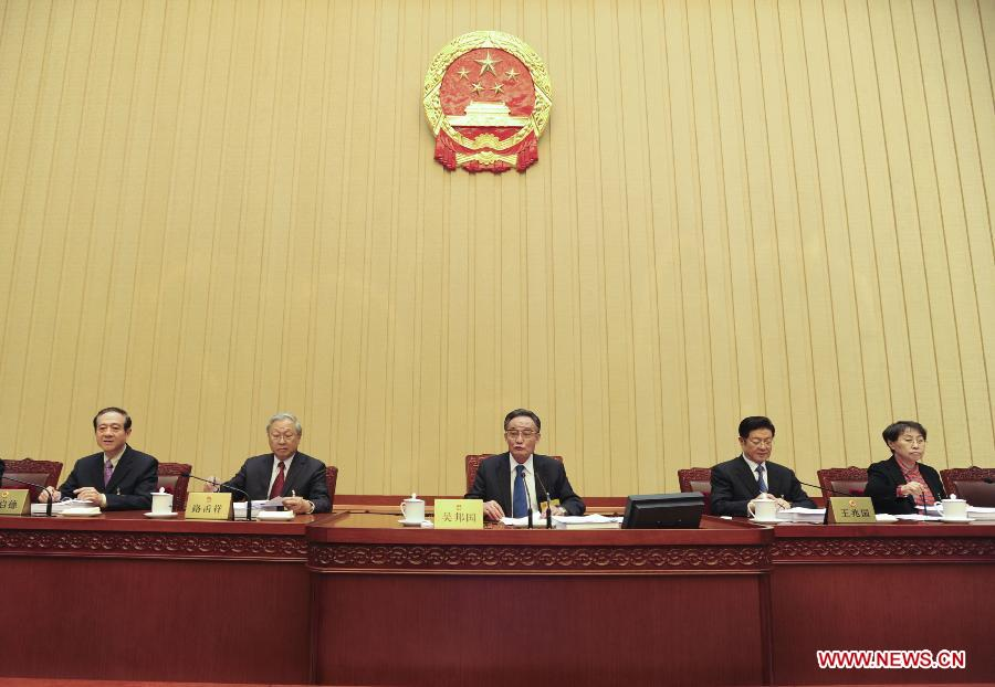 Wu Bangguo (C), chairman of the Standing Committee of the National People's Congress (NPC), presides over a meeting of the 31st session of the 11th NPC Standing Committee in Beijing, capital of China, Feb. 25, 2013. (Xinhua/Xie Huanchi)