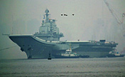China's aircraft carrier anchors in military port