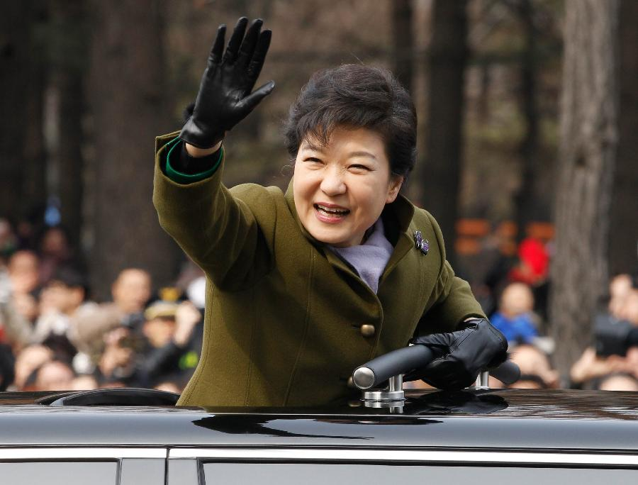 South Korea's new president Park Geun-hye waves after her inauguration ceremony at parliament in Seoul. Park was sworn in as the country's first female president on February 25, 2013.  (Xinhua/AFP Photo)