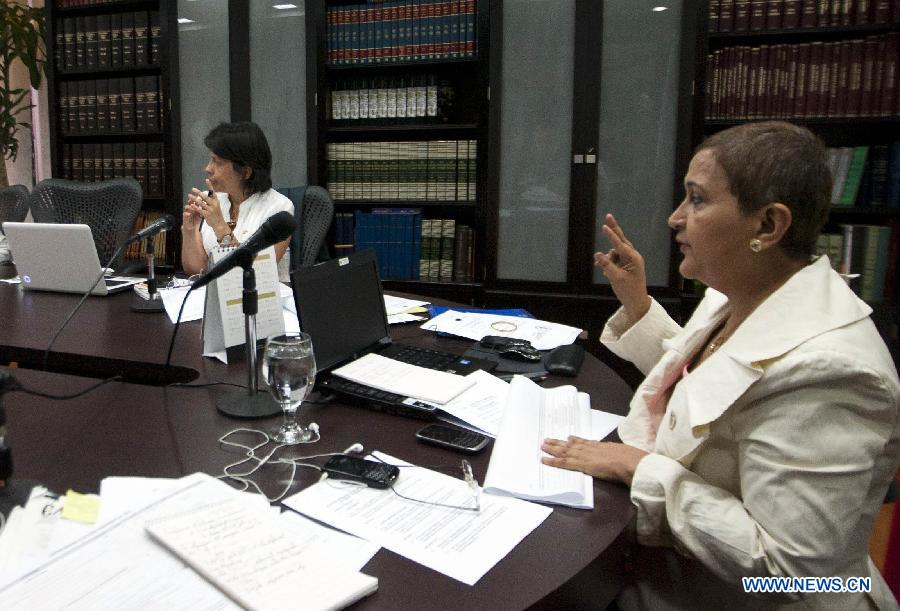 The President of the National Electoral Council of Venezuela (CNE, by its' acronym in Spanish), Tibisay Lucena (R), attends to an extraordinary meeting of the Council in the city of Caracas, capital of Venezuela, on March 9, 2013. Venezuela's National Electoral Council (CNE) announced Saturday after a special meeting of its Board of Directors that the presidential elections will be held on April 14. (Xinhua/Juan Carlos Hernandez)