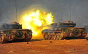 Armored regiment in live-ammunition drill