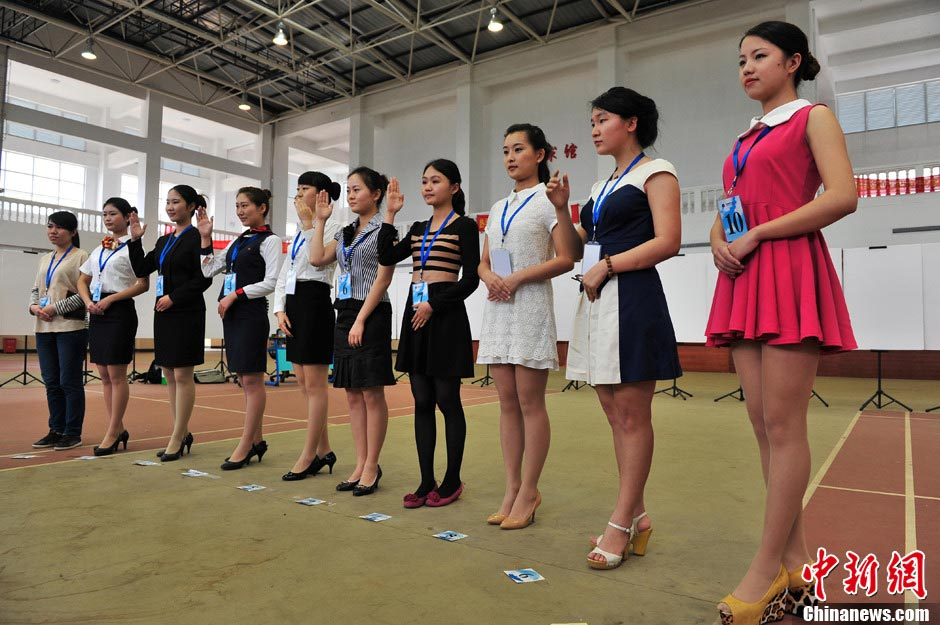 College students apply to become flight attendants for China Southern Airlines in Haikou, capital of South China's Hainan province, March 14, 2013. China Southern kicked off its 2013 recruitment in Haikou. It plans to recruit 96 flight attendants from Hainan, and altogether 1,000 from 12 cities across the country. (CNS/Luo Yunfei)