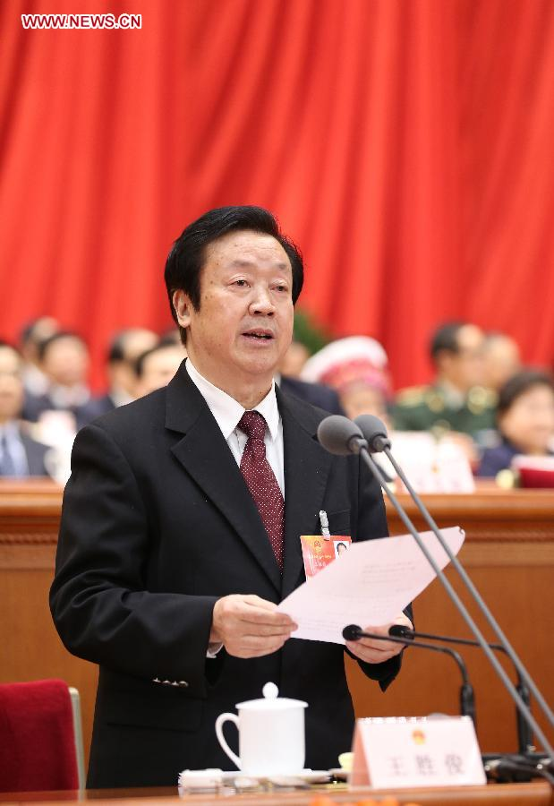 Wang Shengjun presides over the sixth plenary meeting of the first session of the 12th National People's Congress (NPC) at the Great Hall of the People in Beijing, capital of China, March 16, 2013. (Xinhua/Lan Hongguang)