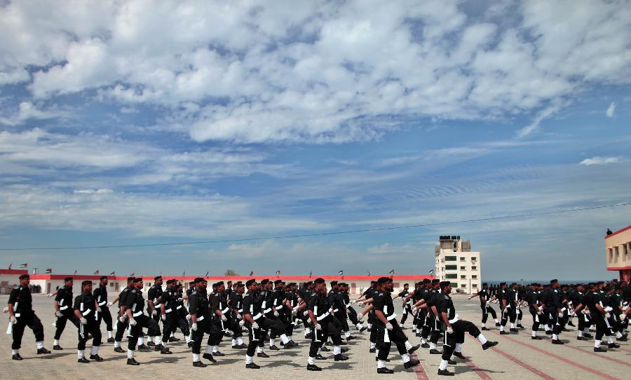Palestinian police officers show their skills during their graduation ceremony at the police academy in Gaza City, on March 19, 2013. (Xinhua/Wissam Nassar)