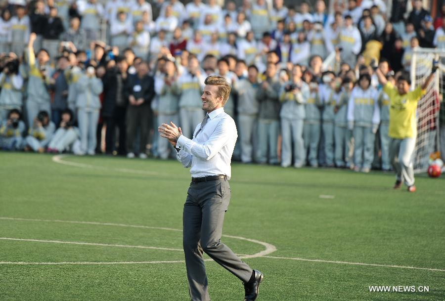 Beckham in Beijing, playing football in suits