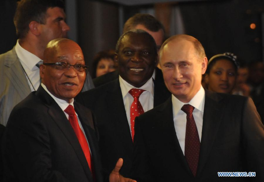 South African President Jacob Zuma(L) greets Russian President Vladimir Putin(R) upon his arrival at International Convention Centre (ICC) in Durban, southeastern port city of South Africa on March 26, 2013. South Africa will host the Fifth BRICS Summit from March 26 to 27, 2013, at the Durban International Convention Center (ICC). (Xinhua/Chang Lin)