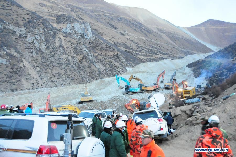 Rescuers work at the accident site after a major landslide hit a mining area of Tibet Huatailong Mining Development Co. Ltd, a subsidiary of the China National Gold Group Corporation, in Maizhokunggar County of Lhasa, capital of southwest China's Tibet Autonomous Region, March 30, 2013. A total of 83 workers were buried in the landslide, which happened on Friday morning. Rescuers have not yet found survivors or bodies 28 hours after the massive landslide. (Xinhua/Zhang Quan)