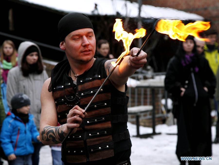 A man shows his stunt with fire during the annual Knight Festival, which opened in the Spandau Zitadelle (Citadel) in Berlin, March 30, 2013. A wide range of activities presenting the life and scene dating back to the European medieval times at the 3-day Knight Festival attracts many Berliners on outing during their Easter vacation. (Xinhua/Pan Xu)