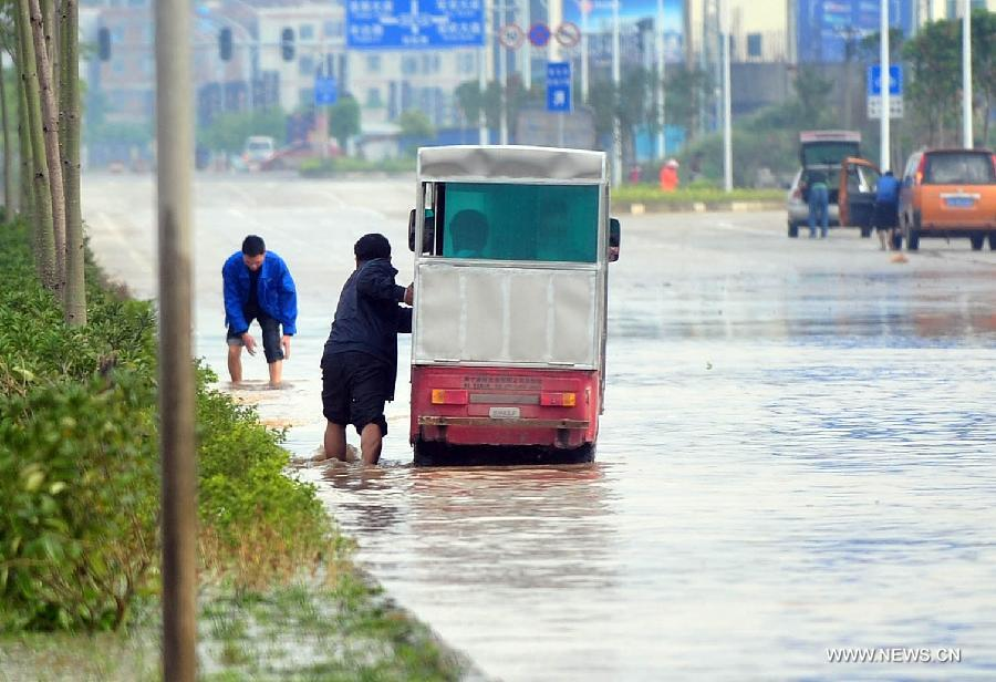 A man pushes his tricycle on the flooded Lingxiu Road in Nanning, capital of south China's Guangxi Zhuang Autonomous Region, April 2, 2013. Parts of the autonomous region, including Nanning, Yulin and Qinzhou, witnessed a heavy rainfall on Tuesday, where rainstorm alerts have been issued by local meteorological authorities. (Xinhua/Huang Xiaobang)
