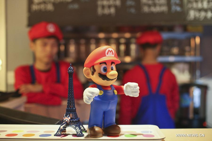 "Waiters in the costume of Super Mario, a famous video game character, work at a Mario themed restaurant in Tianjin, north China, April 8, 2013. The restaurant that opened on Monday attracted many young customers due to its ""Mario-like"" waiters and various decorations. (Xinhua/Fu Wenchao)"