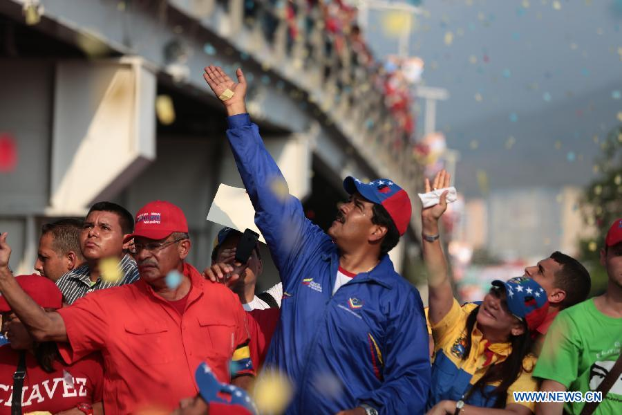 Image provided by Hugo Chavez Campaign Command shows Venezuelan Acting President and presidential candidate Nicolas Maduro attending a campaign rally in Vargas state, Venezuela, on April 9, 2013. Venezuela will hold presidential elections on April 14.(Xinhua/Hugo Chavez Campaign Command)
