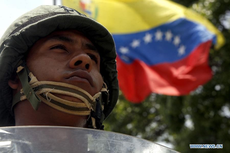 A soldier takes part in the Republic Plan, prior to the Venezuelan presidential elections, in Caracas, capital of Venezuela, on April 10, 2013. Venezuela will hold presidential elections on April 14. The Republic Plan is held to guarantee the security on the presidential electoral process. (Xinhua/AVN)