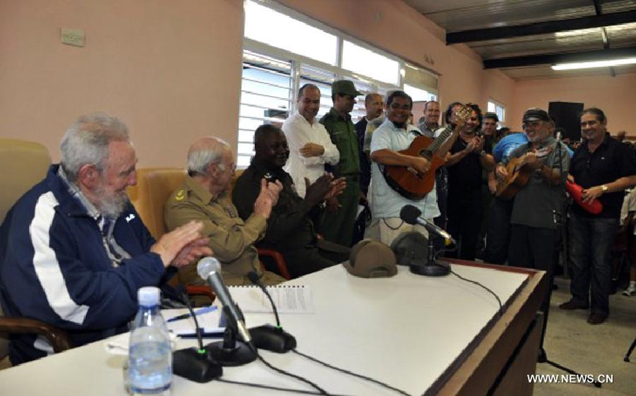 Image provided by Cubadebate on April 11, 2013 shows former Cuban president, Fidel Castro (L), attending the opening of the Vilma Espin Guillois school, in Havana, capital of Cuba, on April 9, 2013. According to the official media, Castro talked for over two hours to students, teachers and other guests to the opening ceremony of the school, which was built thanks to the initiative of former president. (Xinhua/Cubadebate)