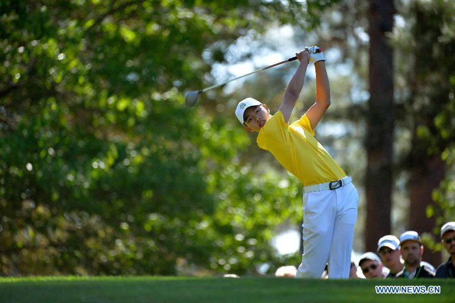 China's Guan Tianlang tees off on the fourth hole during the third round of the 2013 Masters golf tournament at the Augusta National Golf Club in Augusta, Georgia, the United States, April 13, 2013. Guan shot a five-over par 77 Saturday. (Xinhua/Charles Laberge/Augusta National)