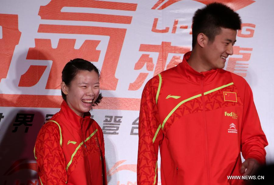 Olympic badminton gold medalist and world No. 1 Li Xuerui (L) and badminton world champion Chen Long of China attend a brand promotion event in Taipei, southeast China's Taiwan, April 15, 2013, ahead of the Badminton Asia Championships which will be held in Taipei arena from April 16 to 21. (Xinhua/Xie Xiudong)