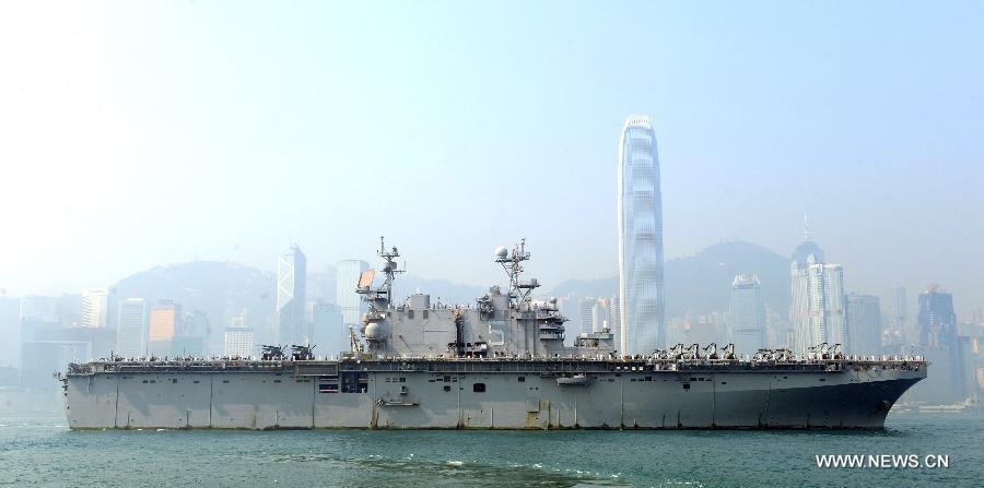 The USS Peleliu, the flagship of the U.S. navy Amphibious Squadron Three, moves into Victoria Harbor in Hong Kong, south China, April 15, 2013. Three ships of the U.S. navy Amphibious Squadron Three started to make a port visit in Hong Kong on Monday to get replenishment. USS Peleliu pulled into the Ocean Terminal besides Tsim Sha Tsui, on the northern bank of the landmark Victoria Harbor in the morning. The other two ships anchored in waters outside the Harbor. (Xinhua/Wong Pun Keung)