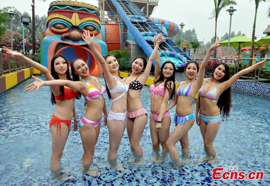 Contestants of the 5th Changlong Miss Bikini Competition pose for photos at the Water Park in Changlong, Guangzhou, the capital of South China's Guangdong Province, April 17, 2013. (CNS/Liu Weiyong)