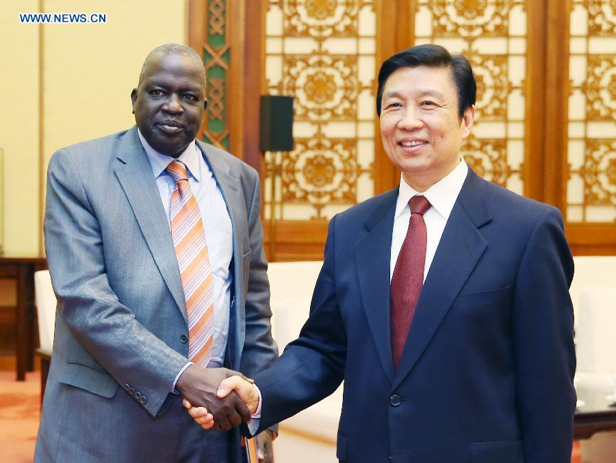 Chinese Vice President Li Yuanchao (R) meets with Kom Kom Geng, head of a delegation from the Sudan People's Liberation Movement (SPLM) of South Sudan, in Beijing, capital of China, April 18, 2013. (Xinhua/Yao Dawei)
