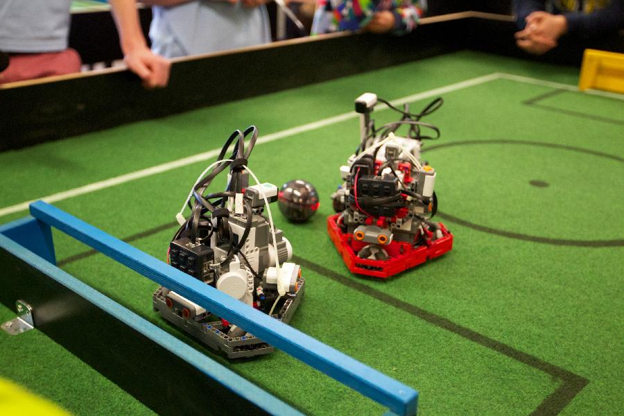 Players control their robots to play football at the Dutch national robot cup in Delft, the Netherlands, on April 20, 2013. (Xinhua/Sylvia Lederer)