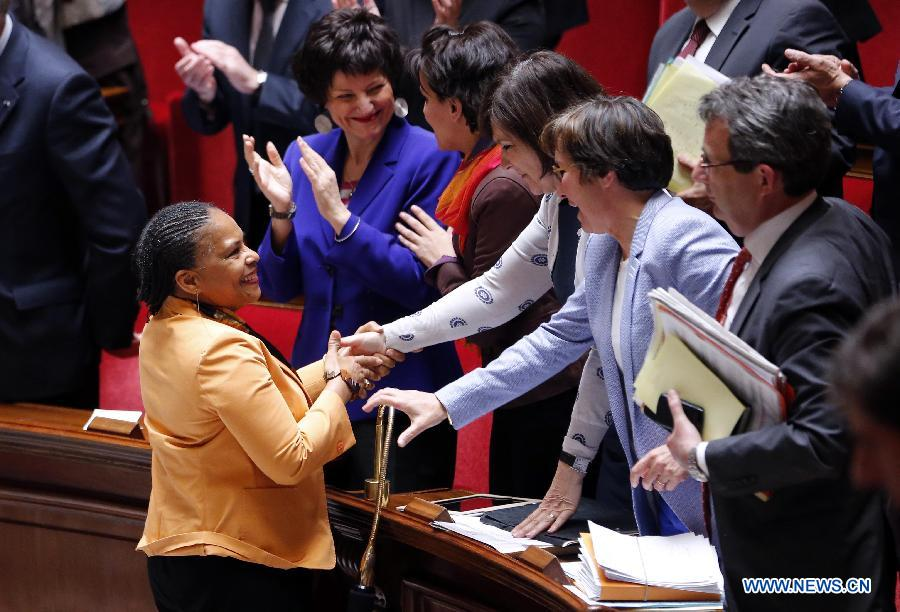 French Justice Minister Christiane Taubira (L) is greeted by left-wing legislators after the vote on same-sex marriage at the French Parliament in Paris, April 23, 2013. As the ruling Socialist Party (PS) enjoys an absolute majority at the National Assembly where 331 legislators voted for the bill and 225 voted against, it successfully paved the way for France to join dozens of other countries, mostly in Europe, to allow same-sex unions and adoption.(Xinhua/Etienne Laurent)