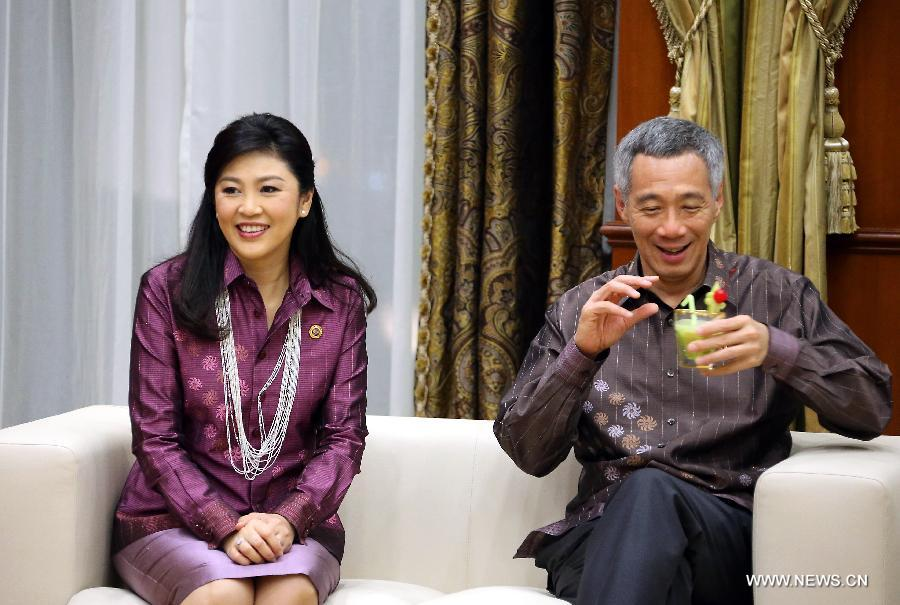 "Thai Prime Minister Yingluck Shinawatra (L) and Singapore's Prime Minister Lee Hsien Loong talks pior to the opening of the 22nd ASEAN Summit in Bandar Seri Begawan, Brunei, April 24, 2013. The 22nd Association of Southeast Asian Nations (ASEAN) Summit opened here Wednesday evening under the theme ""Our People, Our Future Together"". (Xinhua/Li Peng)"