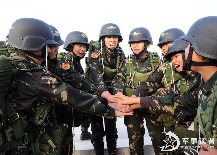 The members from the first female special operation company of the Army of the Chinese People's Liberation Army (PLAA) are in their first parachute landing training on May 14, 2013. (China Military Online/Cheng Jianfeng, Yan Xingxing)
