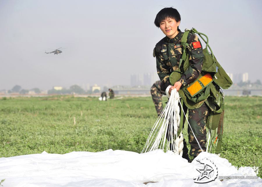 A member from the first female special operation company of the Army of the Chinese People's Liberation Army (PLAA) are in their first parachute landing training on May 14, 2013. (China Military Online/Cheng Jianfeng, Yan Xingxing)