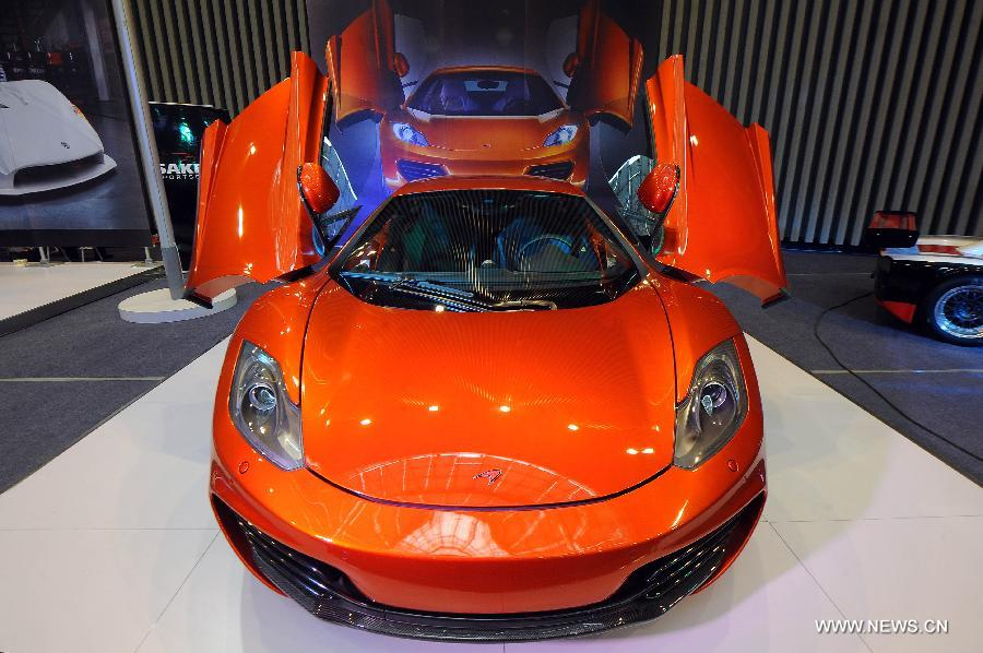 A McLaren sports car is displayed at the 2013 China (Taiyuan) International Automobile Exhibition in Taiyuan, capital of north China's Shanxi Province, May 17, 2013. Some 400 vehicles of 63 brands were taken to the auto show here, which kicked off on May 16. (Xinhua/Fan Minda)