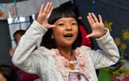 Children take dance class in temporary tent in Lushan