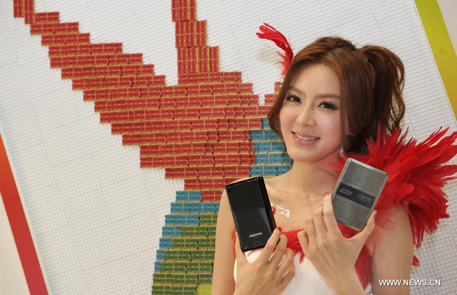 A model presents ADATA storage products at Computex Taipei 2013 exhibition, in Taipei, southeast China's Taiwan, June 4, 2013. The five-day exhibition opened here on Tuesday. (Xinhua/Tao Ming)