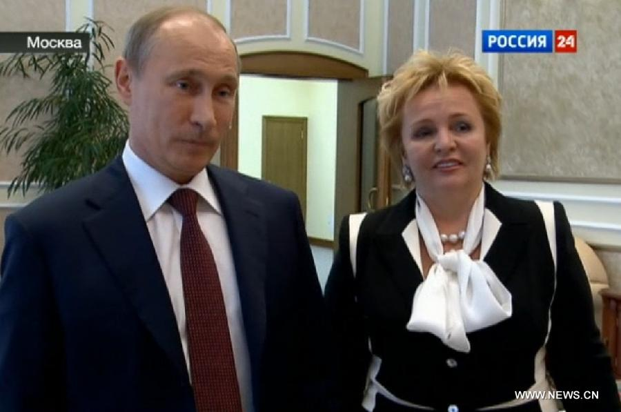 Image taken from video shows Russian President Vladimir Putin and his wife Lyudmila Putina being interviewed in a program on a local news TV channel on June 6, 2013. Putin and his wife Lyudmila Putina on Thursday announced their divorce. (Xinhua)