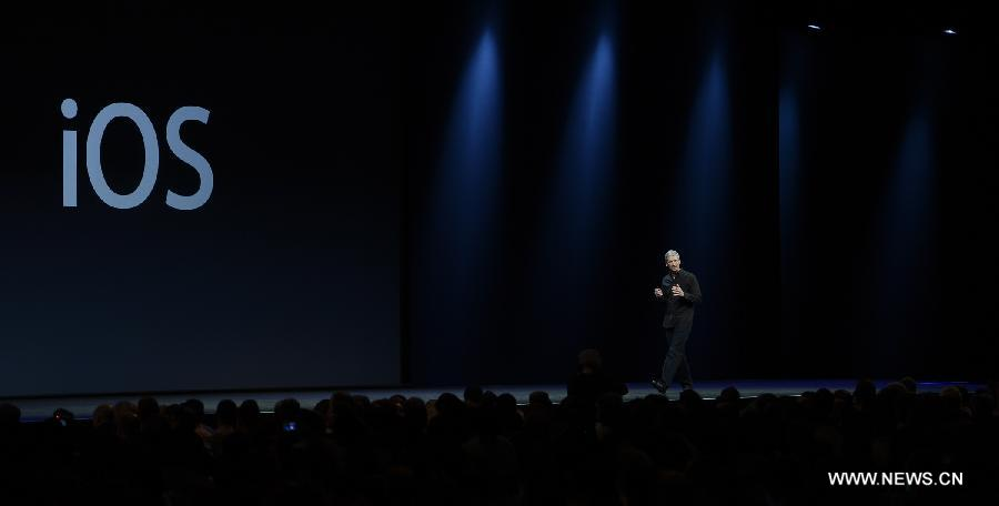 Apple CEO Tim Cook addresses the 2013 Apple WWDC at the Moscone Center in San Francisco, California, the United States, on June 10, 2013. (Xinhua)