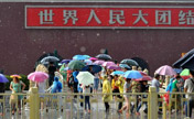 Thunder, rain, hail hit Beijing