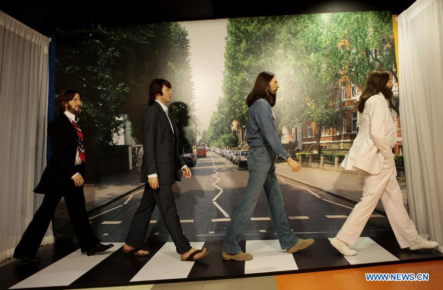 The Beatles' wax figures are exhibited to celebrate the 50th anniversary of their first LP, at Madame Tussauds in Washington D.C., capital of the United States, June 12, 2013. (Xinhua/Fang Zhe)