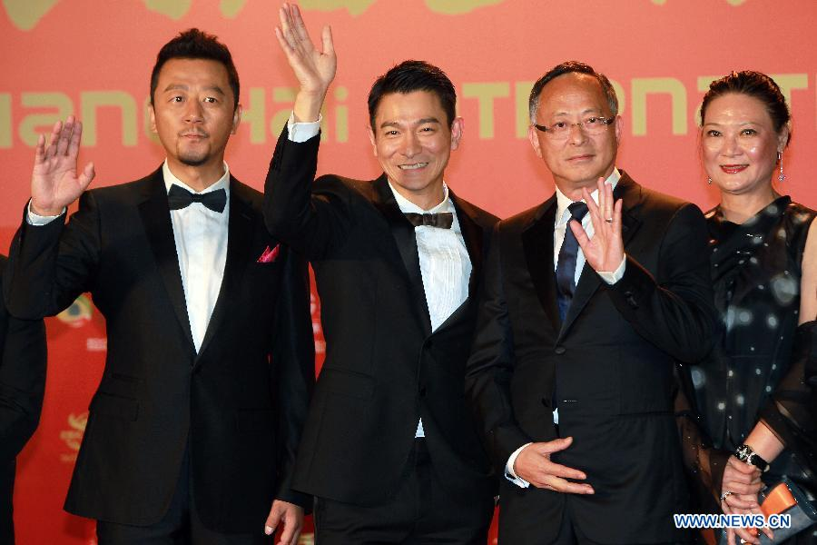 Director Johnny To (2nd R), actors Andy Lau (3rd R) and Guo Tao (1st L) pose on the red carpet for the opening ceremony of the 16th Shanghai International Film Festival in Shanghai, east China, June 15, 2013. (Xinhua/Ren Long)