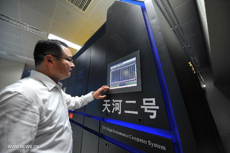 Photo taken on June 16, 2013 shows the supercomputer Tianhe-2 developed by China's National University of Defense Technology. The supercomputer Tianhe-2, capable of operating as fast as 33.86 petaflops per second, was ranked on Monday as the world's fastest computing system, according to TOP500, a project ranking the 500 most powerful computer systems in the world. (Xinhua/Long Hongtao)