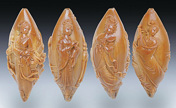 Traditional carvers shape kernels of art