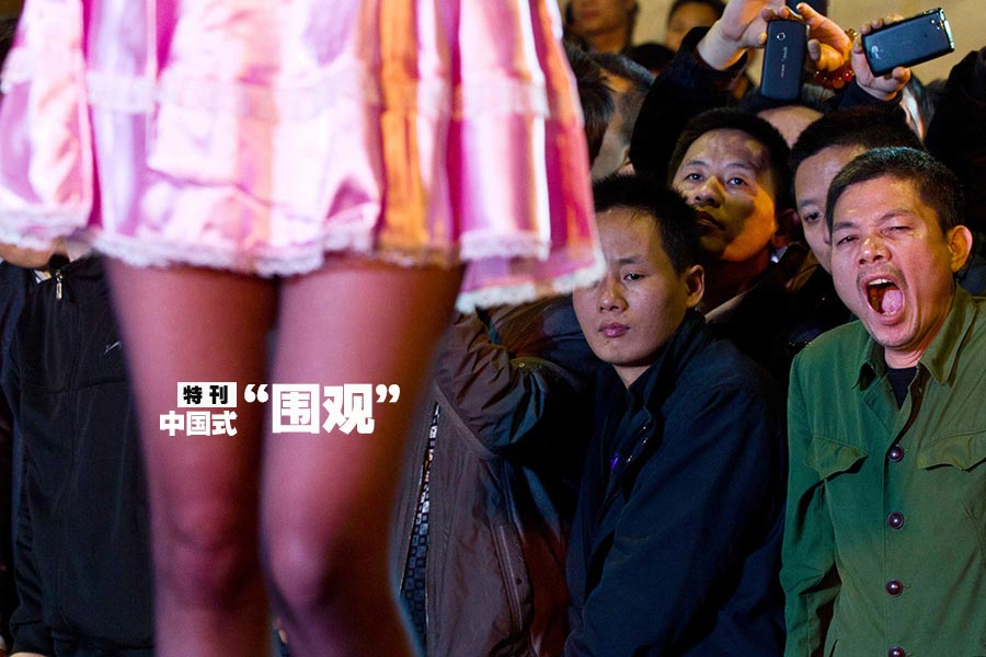 People swarm into an exhibition hall of the third sex culture festival in Nanning, Guangxi autonomous region on Dec. 23, 2013. (Photo/CNTV)