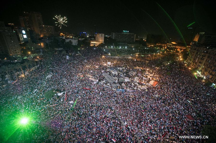Opponents of Egyptian President Mohammed Morsi gather at Cairo's Tahrir Square, Egypt, on July 3, 2013. The chairman of Egypt's Supreme Constitutional Court will run the country for a transitional period, military chief said in a televised speech on Wednesday. (Xinhua/Li Muzi)