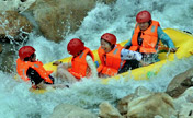 Tourists enjoy river rafting in China's Henan