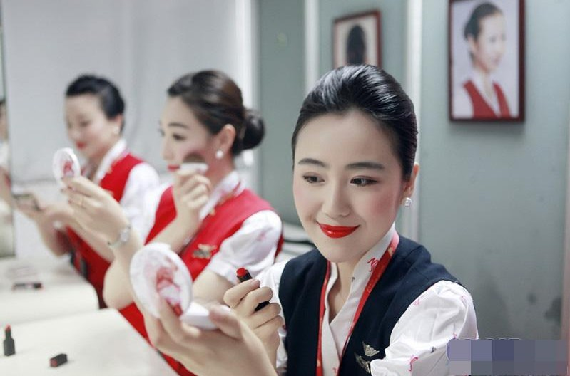 "Air hostesses of the Shenzhen Airlines have their new make-ups from July 1, 2013 for their 20th anniversary. However, this new make-up makes people feel scary. Someone says on the Internet: ""You'd better not choose the Shenzhen Airlines for late flights; it is too scary."" (Photo: gmw.cn)"