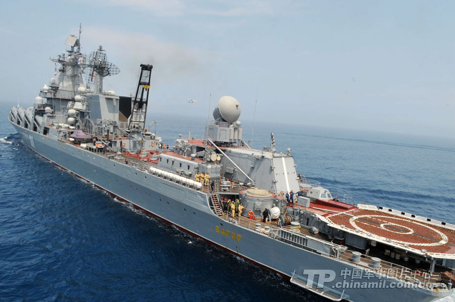"Chinese and Russian warships participating in the China-Russia ""Joint Sea-2013"" joint naval drill conduct joint escort drill in a designated exercise sea area on July 9, 2013. (China Military Online/Sun Yang)"