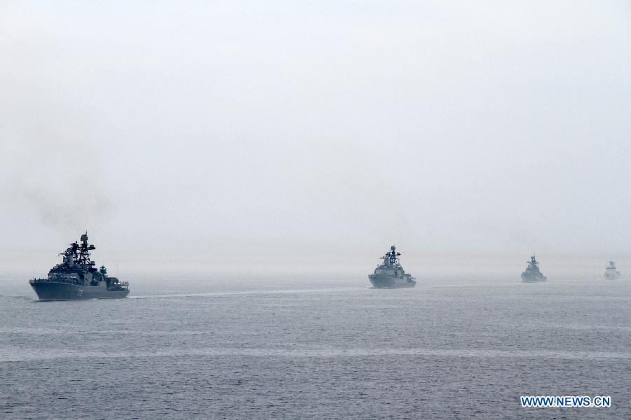 "Naval vessels are seen during a military review of the ""Joint Sea-2013"" drill at Peter the Great Bay in Russia, July 10, 2013. The ""Joint Sea-2013"" drill participated by Chinese and Russian warships concluded here on Wednesday. (Xinhua/Wang Jingguo)"
