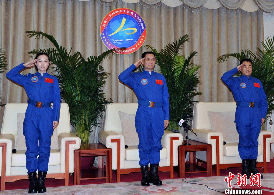 Tree astronauts of China's Shenzhou-10 manned space mission - Nie Haisheng (M), Zhang Xiaoguang (R) and Wang Yaping - are discharged from quarantines on July 11. They are in good conditions and met the press at the space city in Beijing. (Chinanews.com/ Sun Zifa)