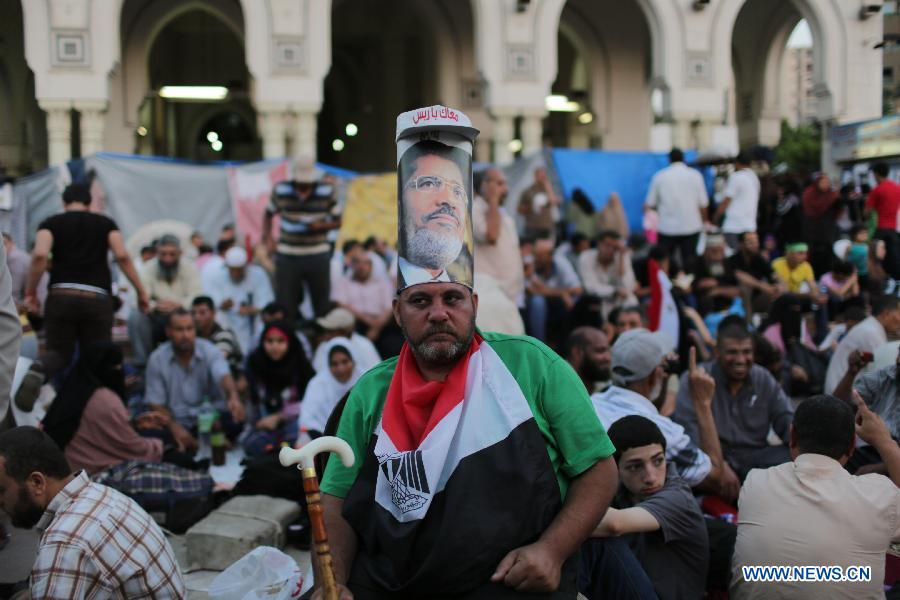 A supporter of ousted Egyptian President Mohamed Morsi attends a protest near the Rabaa al-Adawiya mosque, in Cairo, Egypt, July 12, 2013. (Xinhua/Wissam Nassar)