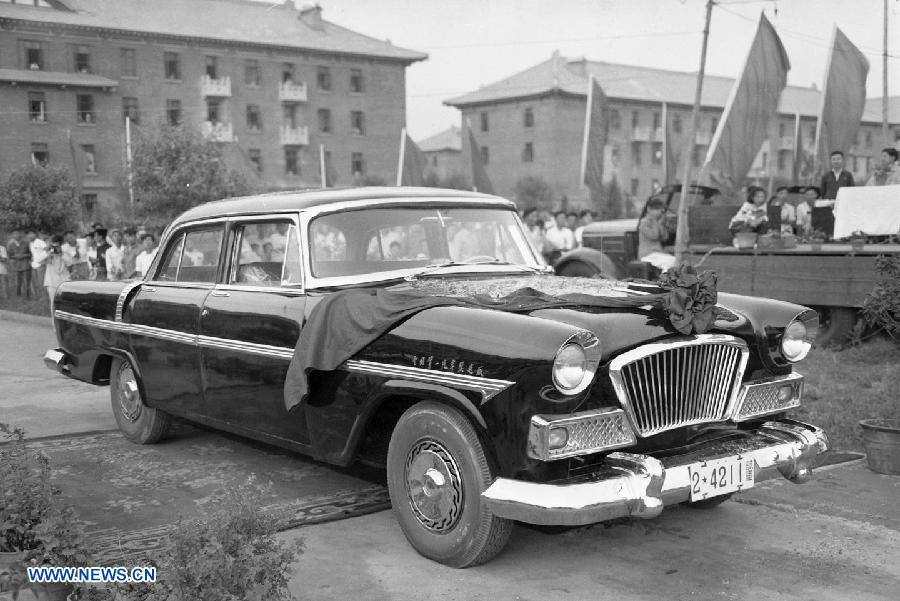 File photo taken on Aug. 1958 shows the country's first self-made limo Hongqi by the First Automotive Works Group (FAW) in China.(Xinhua)