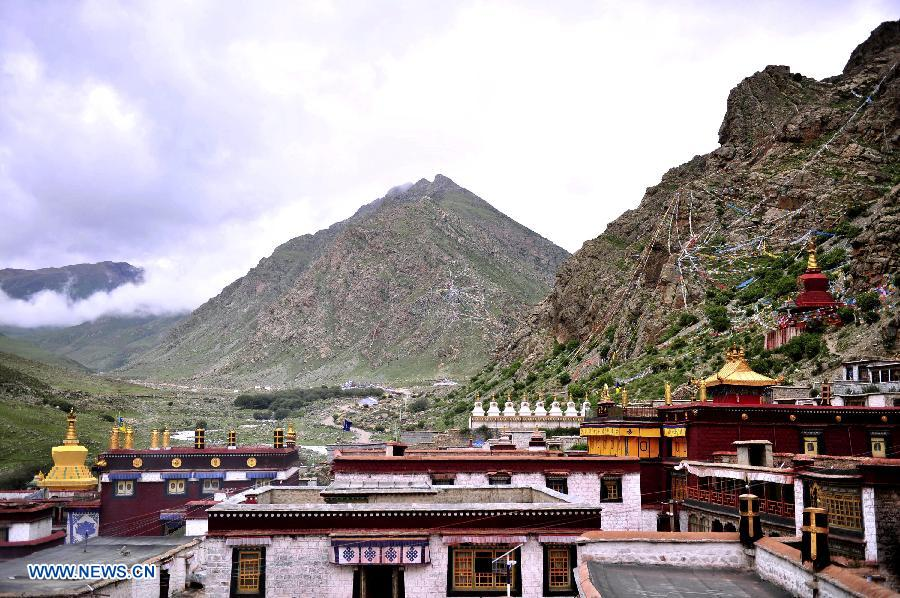 "Photo taken on July 10, 2013 shows the Tsurpu Monastery in Doilungdeqen County, southwest China's Tibet Autonomous Region. Founded in 1189, Tsurpu serves as the traditional seat of the Karma Kagyupa, or ""White Hat Sect,"" of Tibetan Buddhism. (Xinhua/Liu Kun)"