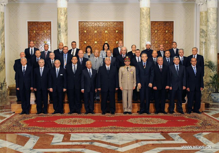 In this hand out picture released by the Egyptian presidency shows Egypt's interim president Adly Mansour (front C) and the newly sworn-in Egypt's interim cabinet pose for a group picture on July 16, 2013 in Cairo. Egypt's interim government, headed by Prime Minister Hazem Beblawi, was sworn in on Tuesday, with no one from Islamic parties included in the interim cabinet. (Xinhua/Egyptian Presidency)
