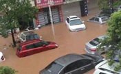 Continuous heavy rain floods downtown Kunming